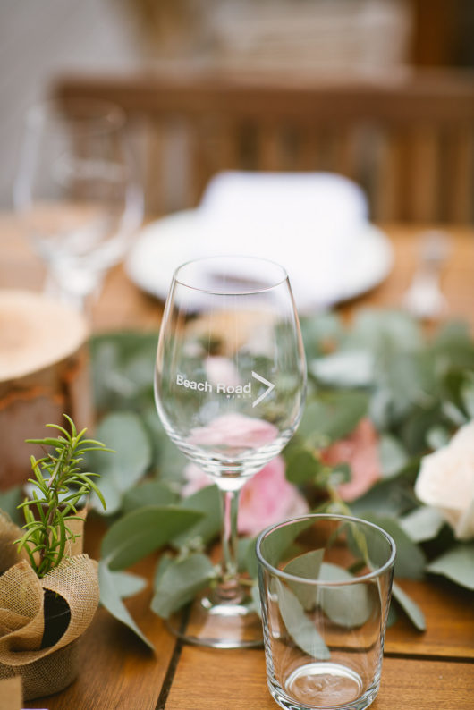 beach road wines glass on table at wedding reception