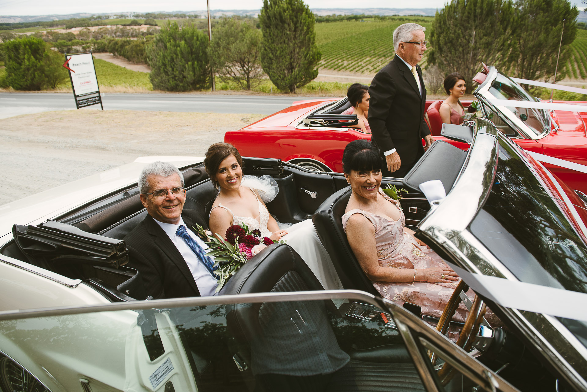 bride and parents in wedding car before ceremony